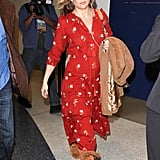 Kate Hudson couldn't help but give her printed maxi dress a boho twist by adding some fringe boots.