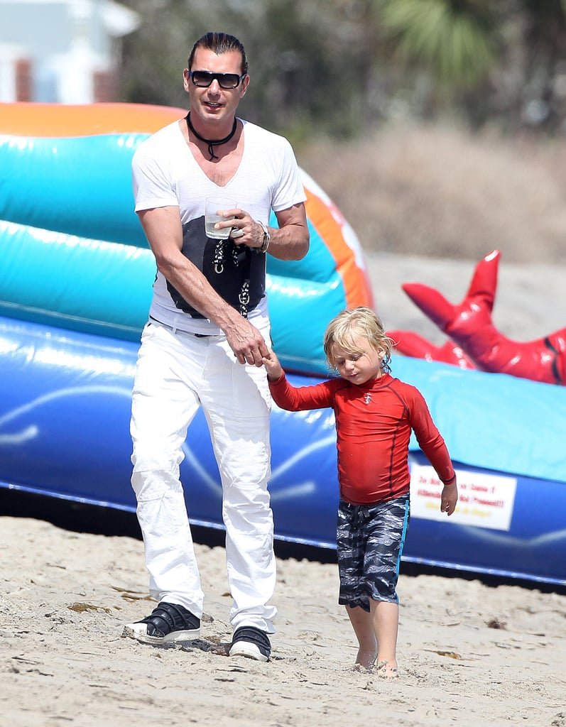 Gavin Rossdale held Zuma's hand while at Joel Silver's annual Memorial Day party in Malibu, CA.