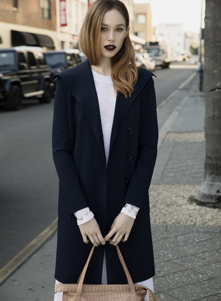 Two everyday styling hacks we swear by? First, shades of navy are more flattering on most skin tones than black. Second, avoid wearing jewellery too symmetrically — mix up the volume on your left and right wrists.    Dress, Wynn Hamlyn. Coat, Trenery. Bag, Ginger & Smart. Bangles and rings, PANDORA Jewelry.