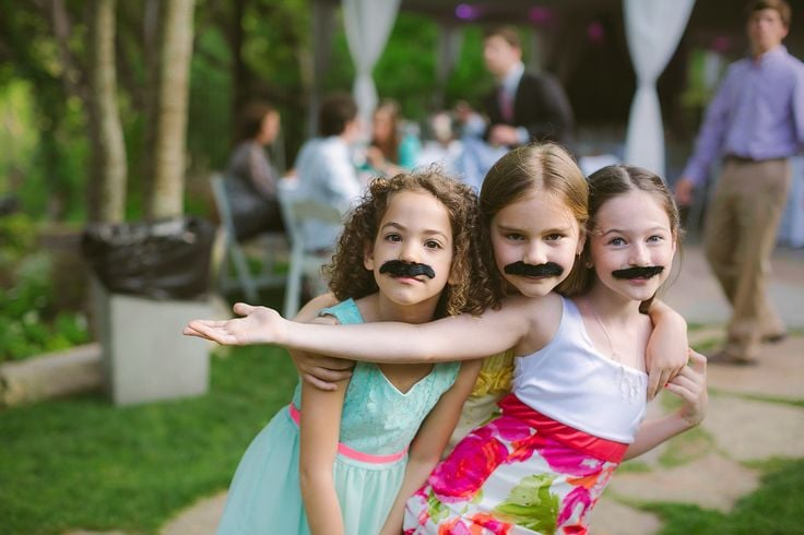 These pint-size wedding guests mustache you a question.