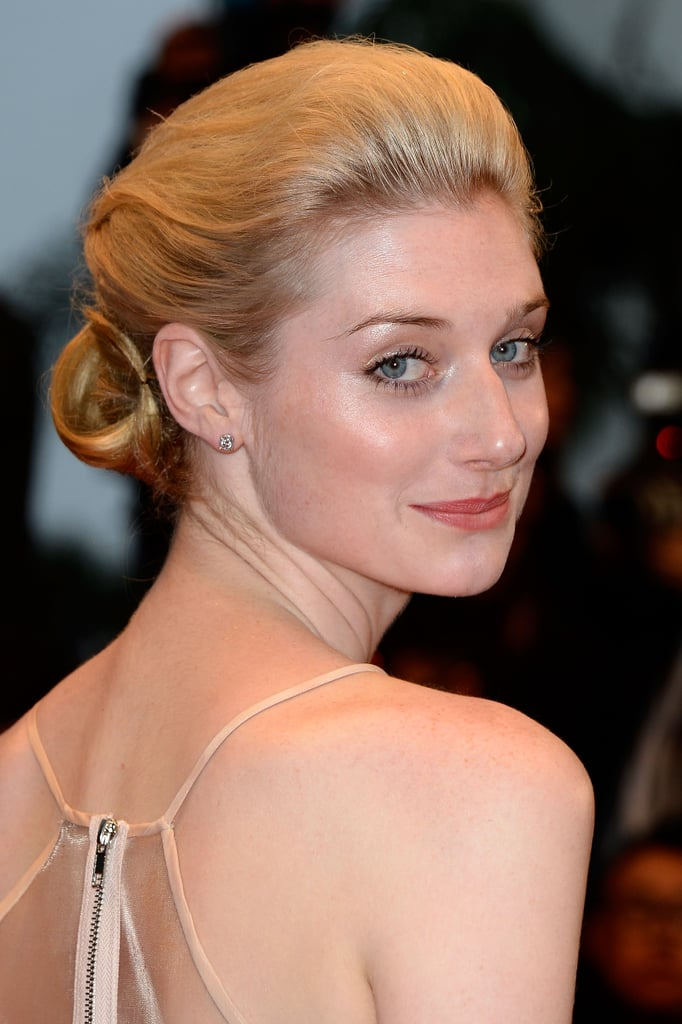 The Great Gatsby actress Elizabeth Debicki wore a tucked-under updo and luminizing makeup for the film's Cannes debut.
