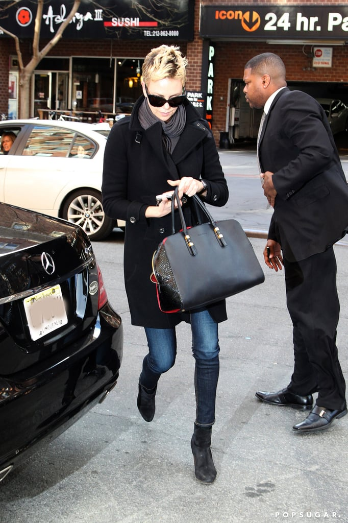 Charlize Theron sported skinny jeans and boots.