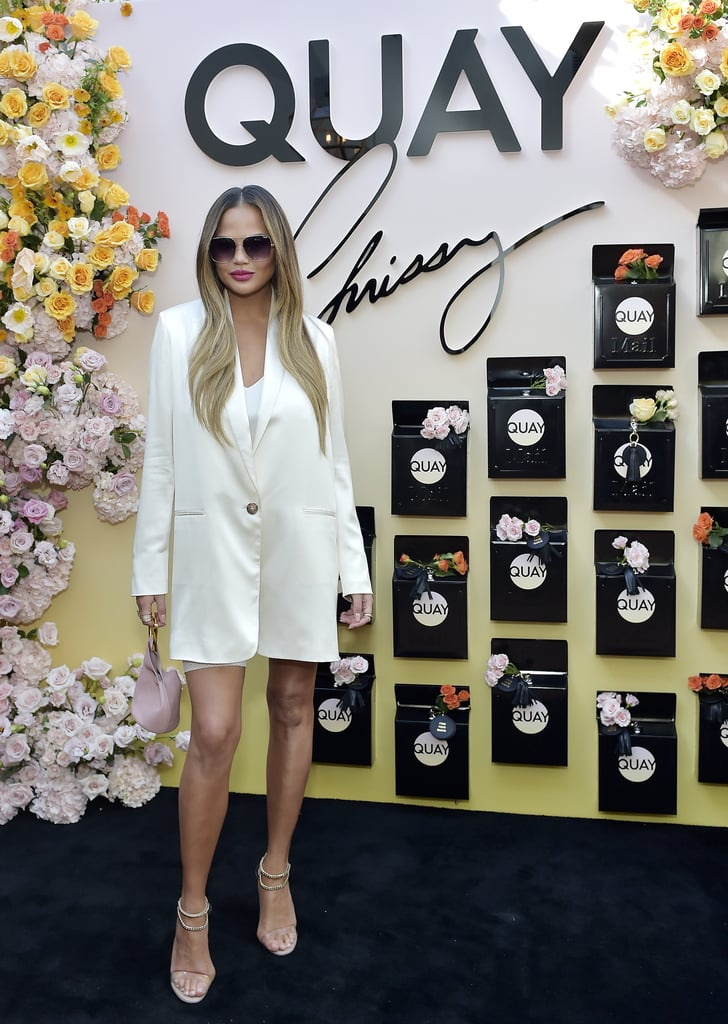 Chrissy Teigen, John Legend, and Luna at Quay Event | Photos