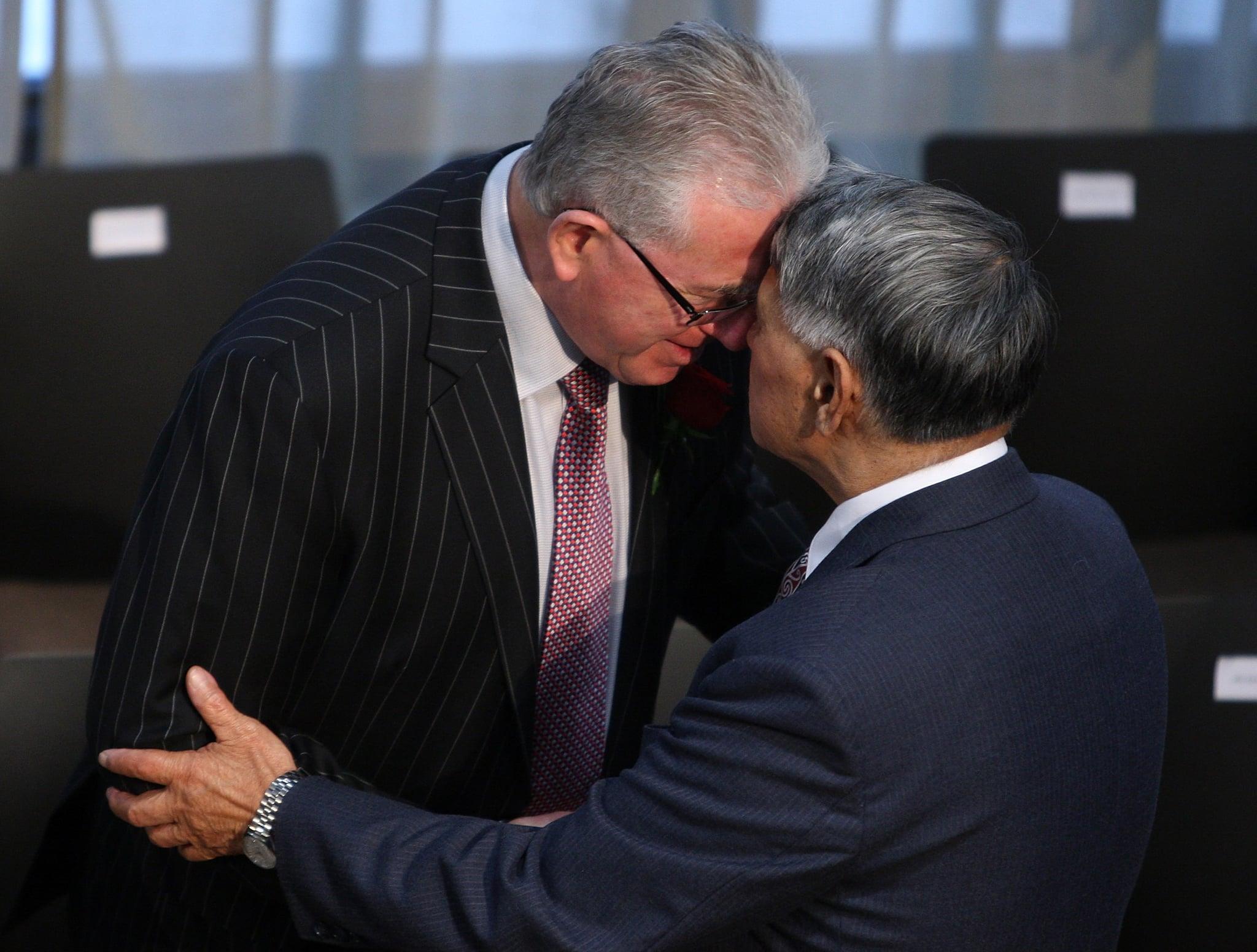 Treaty Negotiations minister Dr Michael Cullen hongis (maori greeting) Te Atiawa kaumatua Sam Jackson during the signing.