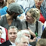 Kirsten Dunst and Oscar Issac chatted during the Olympic basketball game in London.