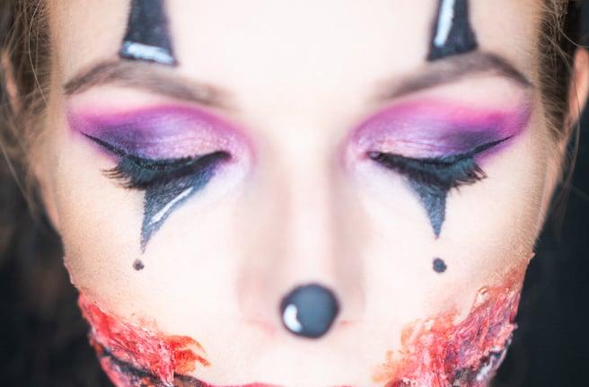 Closeup face of woman with creepy Halloween clown makeup looking into the camera. Creative, artistic, Halloween concept ; Shutterstock ID 1204525261; Job: -