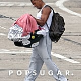 Nick Cannon held Monroe Cannon in a carrier at the airport in Paris.