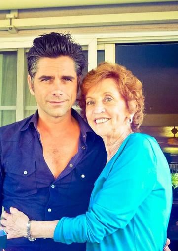"John Stamos celebrated his ""last few hours being 49"" with his mom, and shared this adorable snap. Source: Twitter user JohnStamos"