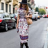 Finish a Boho Fringed Midi Dress With a Dark Style