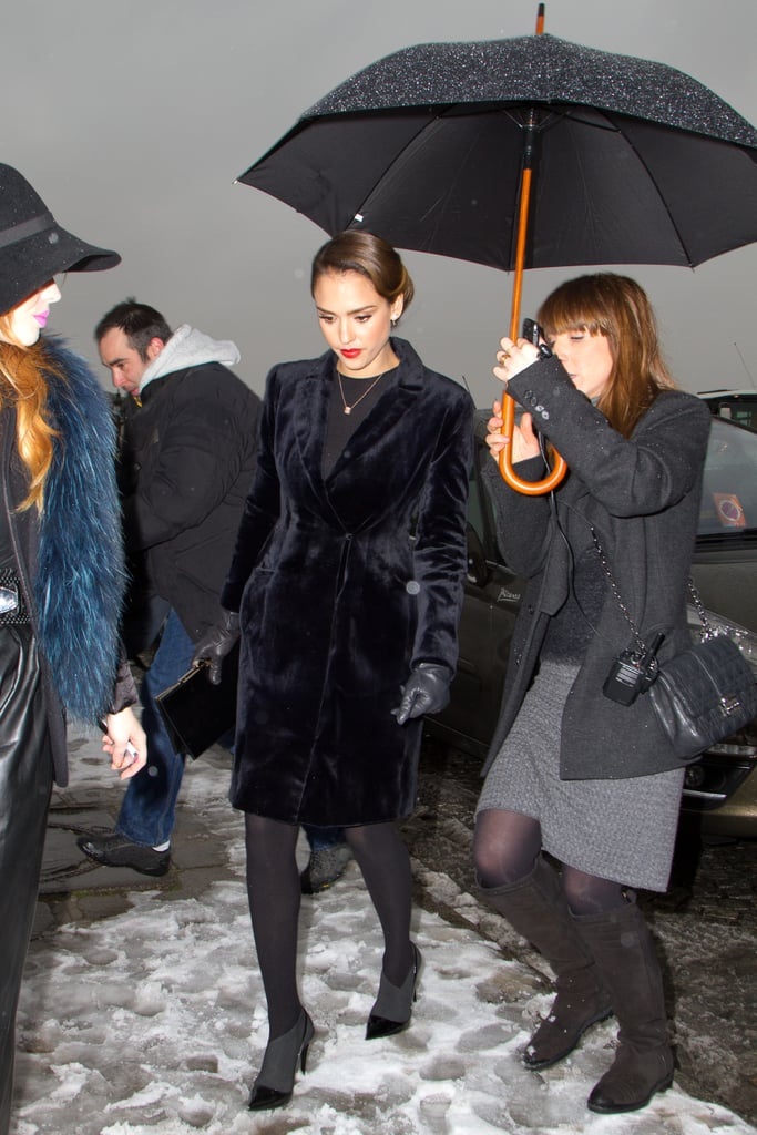 Jessica Alba braved the Parisienne snow in a velvet coat, leather gloves, opaque tights, and two-tone ankle boots.