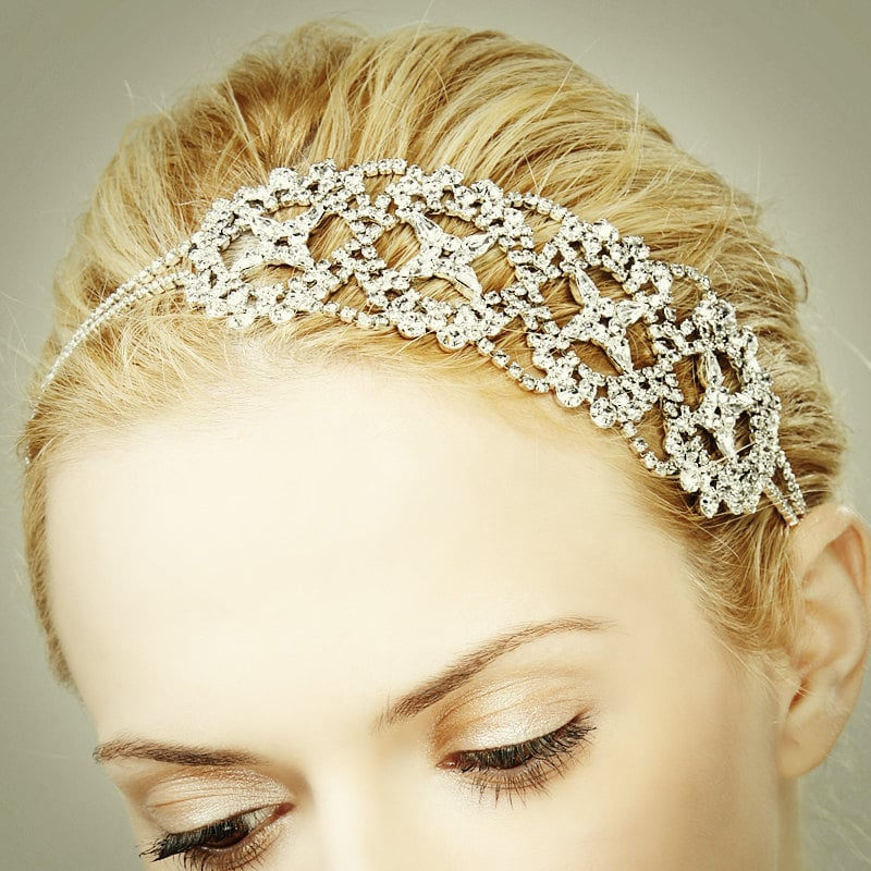 For the glamorous bride, try a scintillating Swarovski crystal headband ($198).
