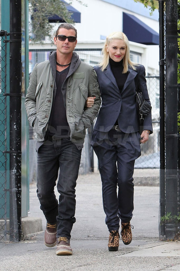 Gwen Stefani held onto Gavin Rossdale's arm as they walked to their cars in Beverly Hills today. The couple were at Kingston's school for a meeting and chatted in the parking lot before driving away separately. Gwen's been juggling her parenting duties with time in the studio for No Doubt, but she's also made a point to focus on the relief efforts in Japan. The singer announced today that she donated $1 million to help the children affected by the earthquake. She's following in the footsteps of Sandra Bullock, who pledged the same amount just last week. Gwen and her boys recently got away for a few days in Palm Springs, where Gavin also played a tennis match against his pal Roger Federer.