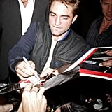 Robert Pattinson signed autographs for fans in Los Angeles.