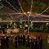"Illuminate your reception with a ""tent"" made entirely out of string lights."