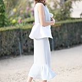 Hanneli Mustaparta charmed in peplum-trimmed white and a pair of red Valentino heels.