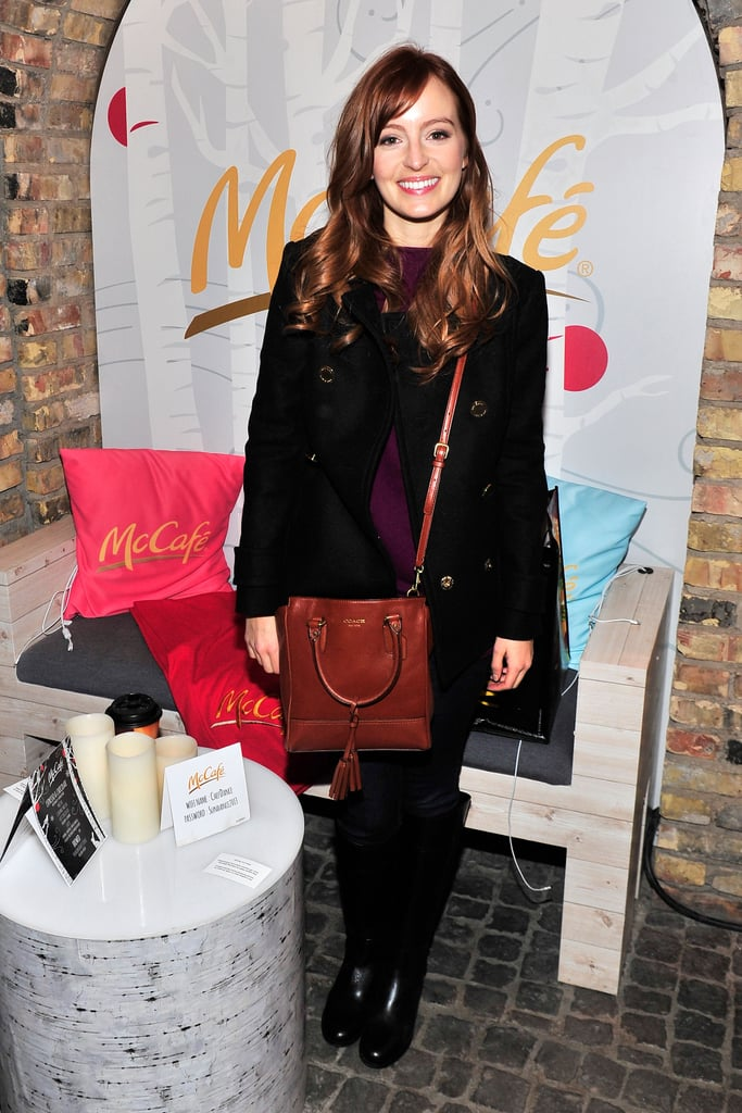 Ahna O'Reilly mixed neutrals with a whiskey-coloured Coach crossbody, classic black peacoat, and matching leather boots, both by Tory Burch.