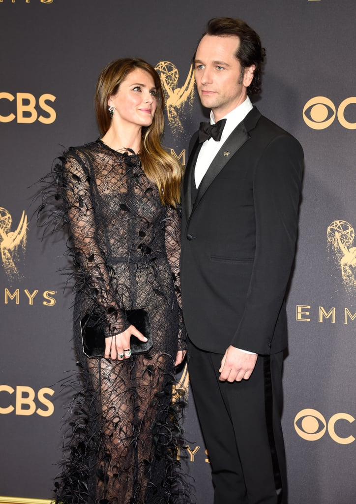 Keri Russell and Matthew Rhys made a fierce duo when they arrived for their big night at the Emmys on Sunday. The couple, who has been going strong since 2013, struck a handful of serious poses on the red carpet before heading inside. Matthew and Keri both received nominations for their respective roles in The Americans — Keri was nominated for outstanding lead actress in a drama series, while Matthew received a nod for outstanding lead actor in a drama series.       Related:                                                                                                           Keri Russell Really Can't Hide Her Smile Around Matthew Rhys               The show itself was also nominated for outstanding writing for a drama series, and it's bittersweet, as The Americans only has a few precious episodes left before it ends for good. The Americans is set to return for its sixth season in early 2018, but until then, take a look at Keri and Matthew's night out at the Emmys.