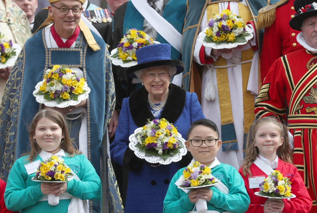 "Queen Elizabeth II looked in good spirits as she attended the Maundy church service at St. George's Chapel on Thursday. The event, which falls on the Thursday before Easter, is a Christian holy day that commemorates Jesus's last supper with his disciples before his crucifixion. The queen fittingly dressed in royal blue as she distributed the traditional Maundy money to various recipients who were chosen in recognition of their service to the community.  While her husband, Prince Philip, was originally scheduled to attend, he backed out last minute after reportedly experiencing trouble with his hip. ""The order of service was printed some weeks ago, when it was hoped the Duke would be able to take part,"" a Buckingham Palace spokesperson said in a statement. ""HRH has since decided not to attend.""  This marks the second event Philip has skipped out on this month. He was expected to attend an event at Windsor Castle with his son Prince Andrew last week but decided not to go. While Philip has only made a handful of public appearances since he retired last May, he is expected to attend his grandson Prince Harry's wedding to Meghan Markle at St. George's Chapel in May."