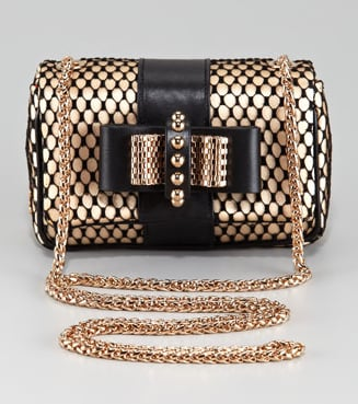 Christian Louboutin's satin lace clutch ($995) is quite a vision, isn't it? We love the mix of black and gold, too.