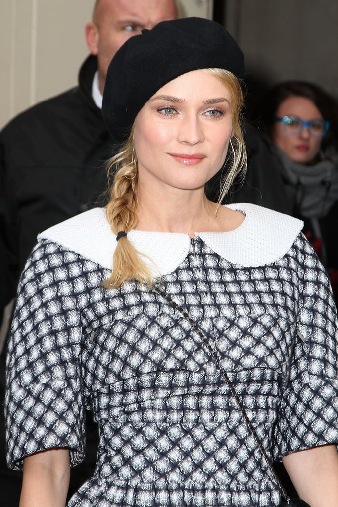 Diane Kruger's schoolgirl charm was on display via the sweet black beret, loose braid, oversize Peter Pan collar, and printed sheath she wore to Chanel's Couture Spring '13 show.