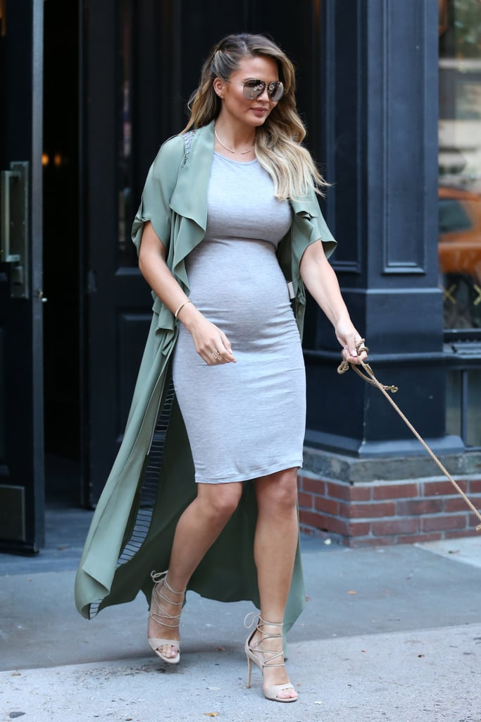 Chrissy seemed to channel Kim Kardashian in her skintight dress, duster coat, and sandals.