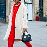 For a Sporty Vibe, Style Your Coat With a Matching Sweatsuit and Neutral Sneakers