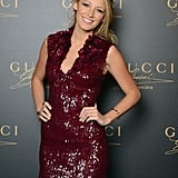 The Gossip Girl flashed her smile and showed off her stems in a burgundy-hued, sequin Gucci minidress.