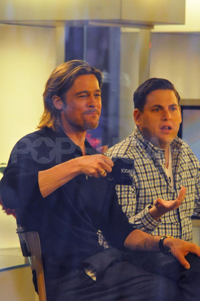 Brad Pitt sipped from a coffee mug.