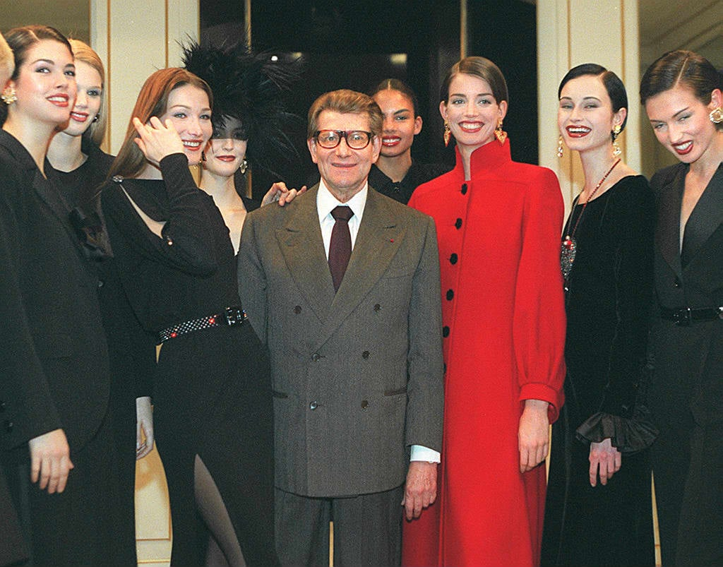 Surrounded by models after his Fall '98 show in Paris.