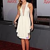 Miley Cyrus in a cream David Koma dress.