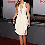 Miley Cyrus in a cream dress.
