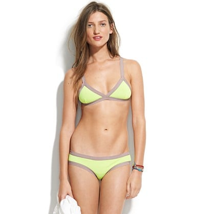 Citron yellow and gray always make a pretty combo, and the sporty cut of this suit is perfect for water sports and beach activities.  Undrest Sao Paulo Triangle Bikini Set ($200)