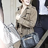 Emma Watson wore a suede trench leaving her hotel.