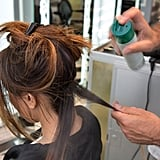 Now that your hair is dry, section off your hair starting at the nape. Next, grab a one- to two-inch section of hair and mist with hairspray to prep the hair before you curl.  Pipino used Kerastase Resistance Double Force hairspray ($18-39) for heat protection, texture, and flexible hold.