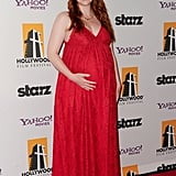 Bryce Dallas Howard showed off her baby bump in a deep red Dolce and Gabbana dress.