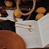 Wear book-themed jewelry.