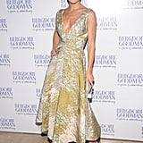 Carolyn Murphy attended the party in a pretty tea-length printed dress and orange heels.