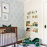 "The reading nook is a special place for Brooke, who loves to read with older son Lincoln and looks forward to doing the same with baby Calvin. J & J Design Group handmade the ""Read to Me"" letters using pages from vintage storybooks."