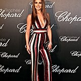 Hitting the Chopard Trophy Ceremony in Cannes, Cheryl wore a plunging Zuhair Murad jumpsuit.