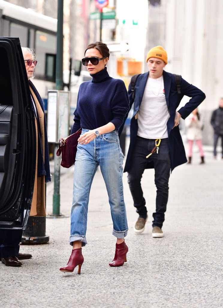 Earlier that month, she accessorized her fairly simple outfit with a pair of burgundy booties.