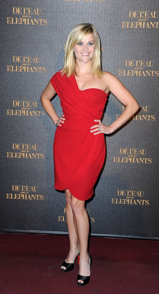 Reese sizzled in a red asymmetrical dress and peep-toe heels at the Paris premiere of Water For Elephants.