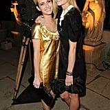 Emma Roberts and Jaime King hug at a Miu Miu party.