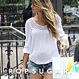 Gisele Bundchen wore white and denim for a little shopping in Boston.