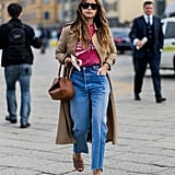With a simple tee and a chic trench