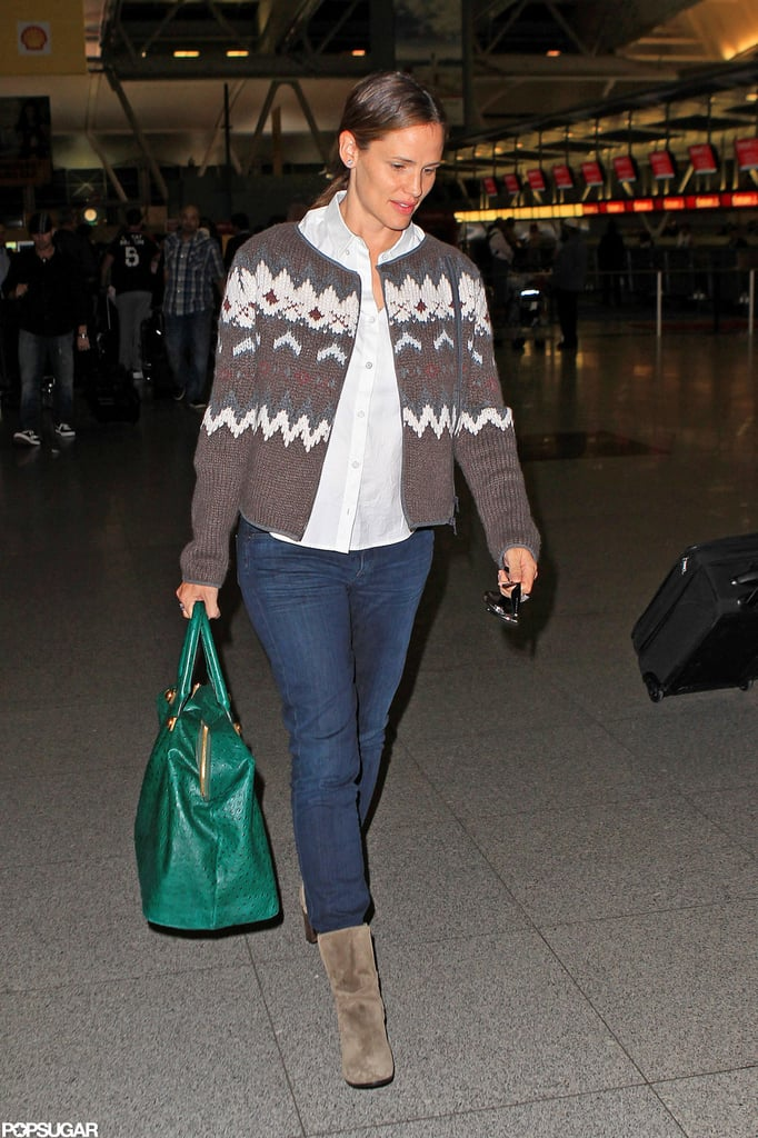 "Jennifer Garner landed at JFK after taking off from LAX yesterday. She was all smiles as she stepped out of a black SUV in LA and bid farewell to her driver before heading inside the airport with a large green tote on her arm. Jen's off on a trip while husband Ben Affleck just returned home following a visit to Spain. Ben traveled to Europe for this year's San Sebastián Film Festival, where he premiered Argo for an international crowd. Jen's stepping up her own promotional tour for her upcoming release, Butter. She pretaped an interview with Ellen DeGeneres, airing today, in which she shared funny stories about Ben's ""wonder sperm"" and misplacing her son."