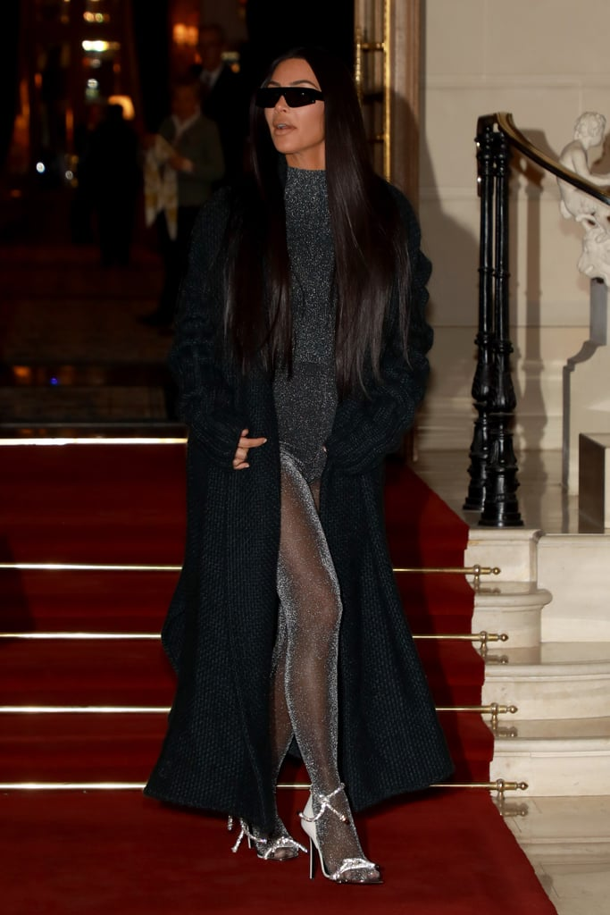 Did Kim Kardashian bottle up all the stars in the solar system for this extravagant night-out look? The jury's still out. Kim continues to rewrite the rules of fashion with her bold couture outfits (remember that daring Mugler dress?), so it's almost impossible to be surprised by her picks.  She recently stepped out for an evening with Kimora Lee Simmons in Paris, and naturally, the normal jeans and t-shirt wouldn't do. Instead, Kim showed off a high-neck bodysuit and paired it with Versace tights and glittering heels, also by the designer. She finished off the ensemble with a floor-length black cardigan and sunglasses, likely from her own collection. Ahead, see more snaps of Kim's look from all angles.        Related:                                                                                                           Kim Kardashian and North West Give the Standard Mommy-and-Me Outfit a Run For Its Money