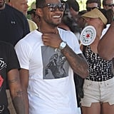 Usher laughed with friends at the festival in 2012.