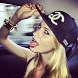 Poppy Delevingne rocked a Chanel snapback and red lipstick. Source: Instagram user poppydelevingne