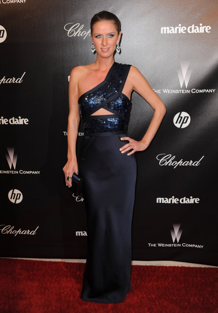 Nicky Hilton hit up the Golden Globes afterparty circuit wearing a sexy cutout navy blue gown, paired with gorgeous diamond jewels and a box clutch.