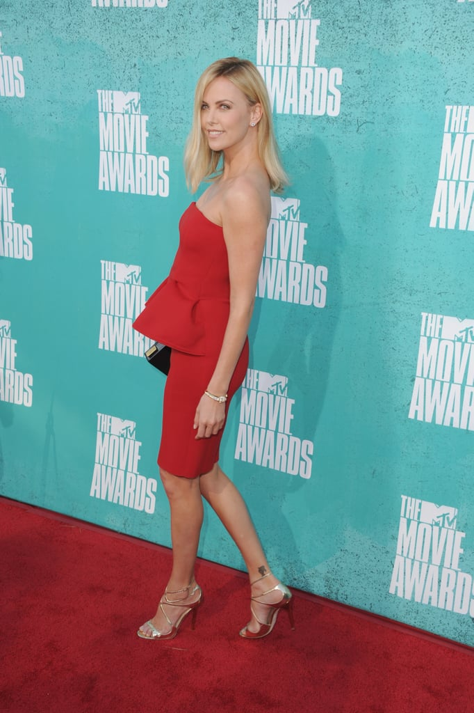 Charlize Theron smiled for photos at the MTV Movie Awards.